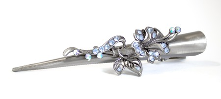 Classical barrette with flowers and blue crystals, is isolated on a white background  Stock Photo