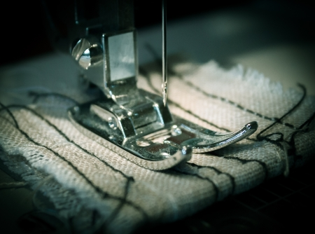 Sewing machine and a linen rag  Focus on the needle  Stock Photo