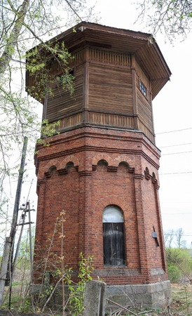 refilling: Old water tower for refilling steam locomotives water. Russia, Tver Region, Udomlya. Stock Photo