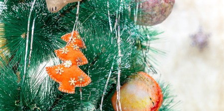 merry mood: New Year background with a toy on Christmas tree branch. Stock Photo