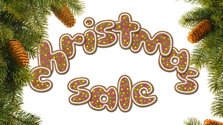 circuit sale: The inscription Christmas sale, consisting of cookies. Isolated on white. On both sides of spruce branches with cones. Stock Photo