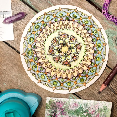 Hand-painted zendala, mandala among materials for creativity on a wooden table. Zentagle. Flat lay Stock Photo