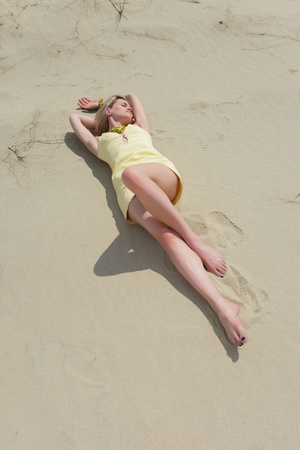 sexy blondie lying on the sand  photo