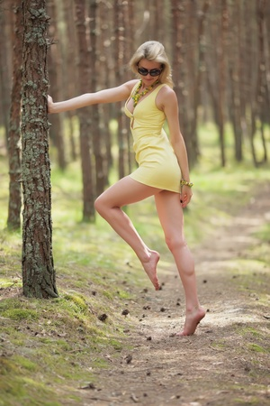 young woman on a background of pine trees on the Curonian Spit in Russia  photo
