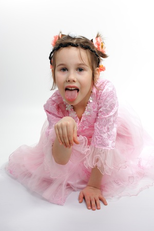 Little girl stuck out her tongue and took a pose like a puppy  photo