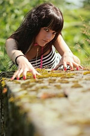 tigress: Nice girl in a pose of a tigress Stock Photo