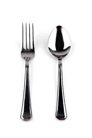 Steel spoon with a fork on a white background photo
