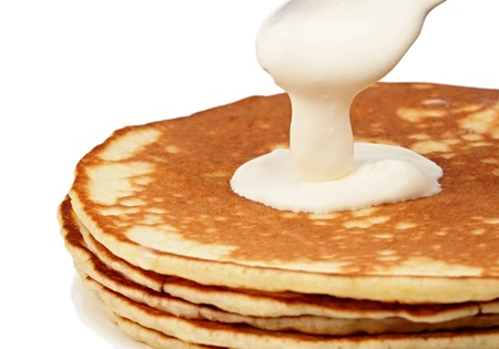 Pancakes with sour cream close up photo