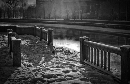 blackandwhite: Old quay on the river Pregel in Kaliningrad, opposite the cathedral, in a retro style. Black-and-white image.
