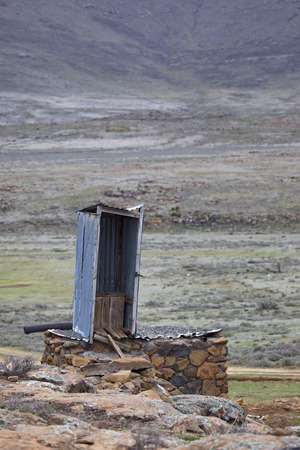 basic: Basic sanitation pit latrine in Lesotho Stock Photo