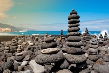 Stack of stones on the sea beach. Tenerife. 스톡 콘텐츠