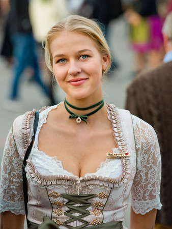 Munich, Germany - October 07, 2018: Young sexy oktoberfest girl in national costume at the biggest folk festival in the world - the oktoberfest. 新聞圖片