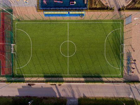 Green football stadium field. Aerial top view.