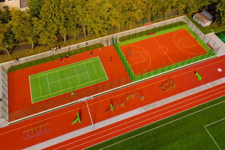 Sports ground top view. Aerial view of tennis and basketball court. Sports ground.