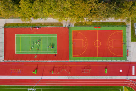 Sports ground top view. Tennis and basketball court. Aerial view.