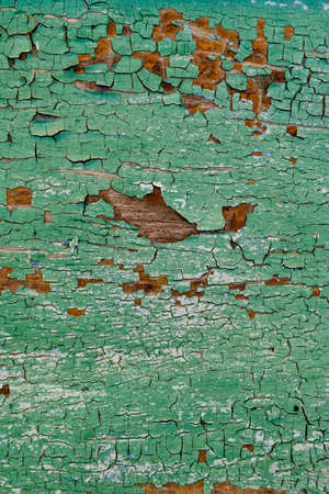 Old green board with cracks.