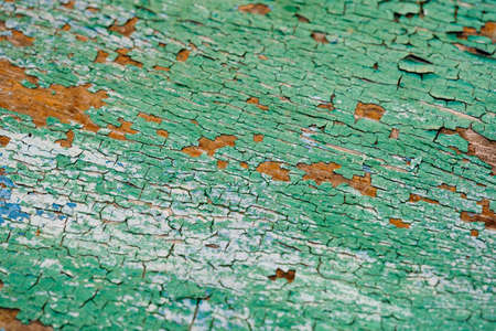 Old green board with cracks. Selective focus. Banco de Imagens