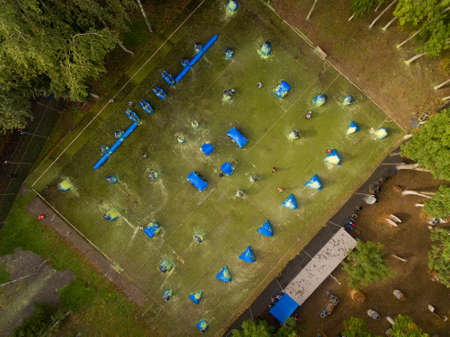 Aerial view of paintball court in the city public park. Top view. Фото со стока