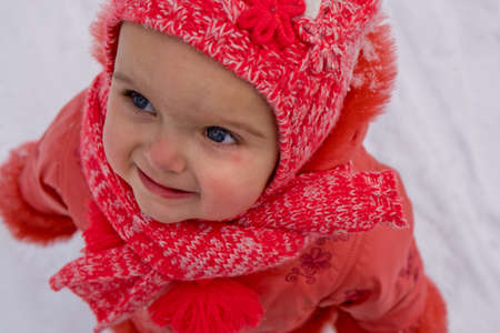 Winter close up outdoor portrait of adorable baby girl. Close-up.