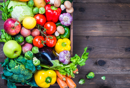 fruit and vegetables: Vegetables and fruits on rustic wood background copy space. Stock Photo