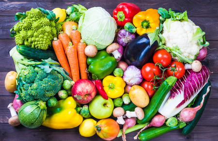 Vegetables and fruits on rustic background.