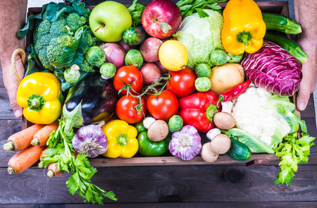 Organic vegetables and fruits in a wood box. Stok Fotoğraf
