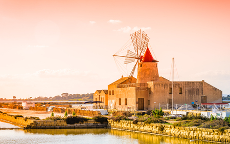 Sicily, Trapani wind mill sea salt production, Italy. Stok Fotoğraf