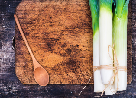 Leek on chopping board text space.