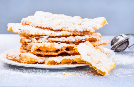 crostoli: Italian carnival pastry.Traditional carnival desserts, chat or crostoli, lies, rags. Stock Photo
