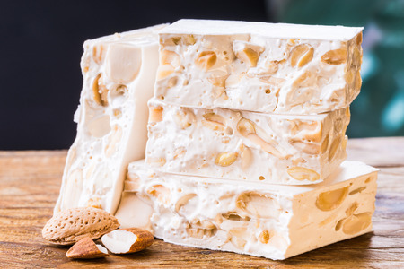Nougat or nougat on wood background.