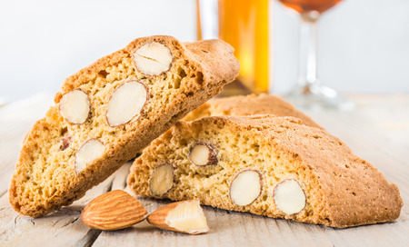 Cantuccini on white wooden background, typical tuscan biscuits.