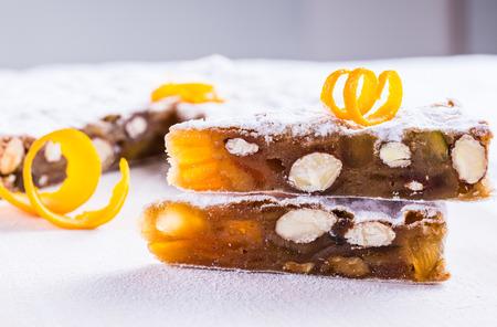 fruitcake: Panforte traditional italian christmas dessert, fruitcake typical of Siena, gingerbread.