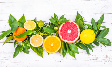 clementines: Citrus fruits on white background wood. Fruits table decoration. Stock Photo