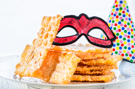 crostoli: Italian carnival pastry.Traditional carnival sweets, chat or crostoli, lies, rags. Stock Photo