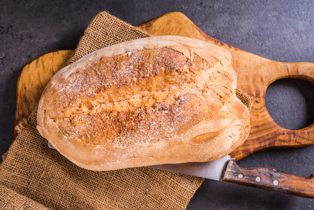 Bread on wood board top view.