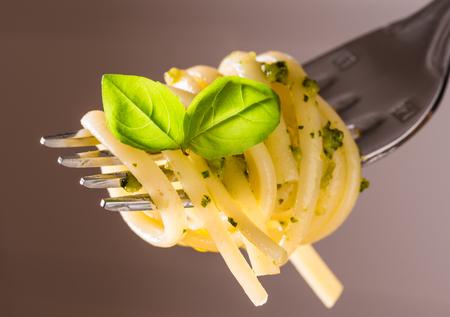 Pasta with pesto.Fork with pesto spaghetti. Stok Fotoğraf