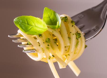 Spaghetti with pesto sauce.