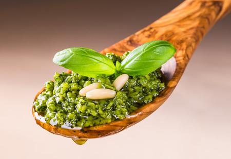 Pesto sauce with basil closeup.