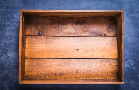 Vintage wooden box empty copy space on dark background top view.