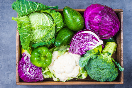 savoy cabbage: Variety of cabbages in rustic wood box top view.Organic winter farm vegetables.