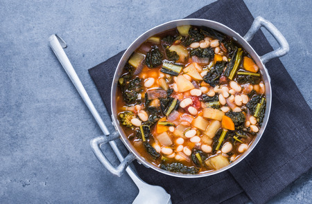 Soup with beans, kale, vegetables viewSoup top with beans, kale, vegetables top view.Vegetarian food. Stok Fotoğraf