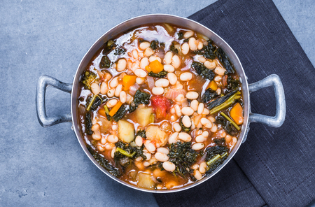Soup with beans, kale, vegetables top view.Typical tuscan ribollita soup. Stok Fotoğraf