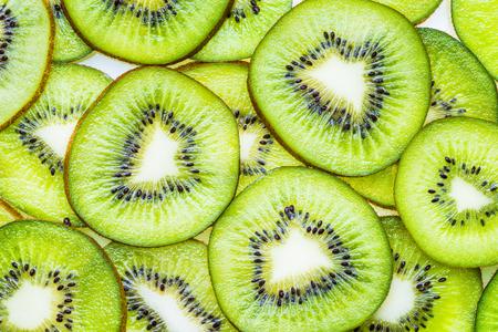 Kiwi fruit slices, green fruit flat lay.