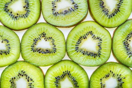 Kiwi fruit macro, fruit green background flat lay.