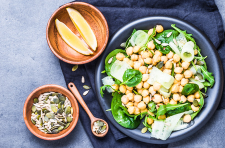 Salad with chickpea and greens, seeds top view.Vegan healthy food plate. Stok Fotoğraf