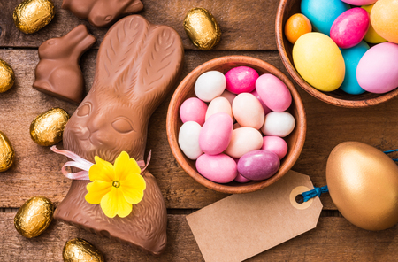 Easter eggs and bunny on rustic wooden table, easter holiday background.