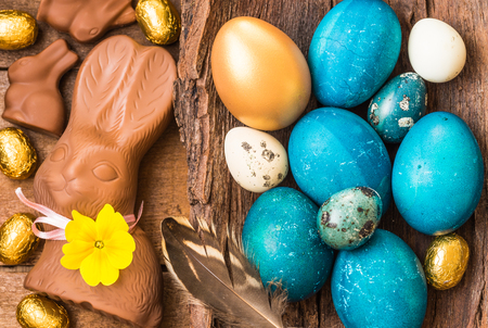 Easter holiday background with colorful easter eggs and bunny.