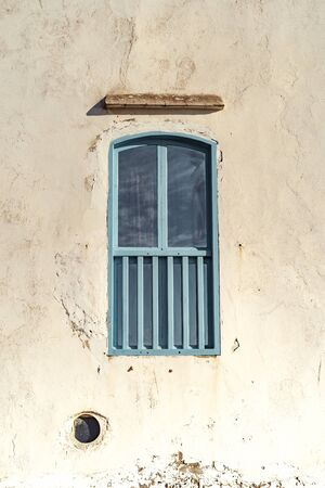 a blue street with multicolored doors in Morocco photographed on a Sunny day