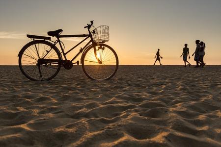 meditaion: Bicycle Standing on the Beach During Sunset in Hikkaduwa, Sri Lanka