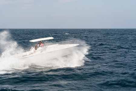motor launch: White Motor Boat Rushing Through the Waves in Indian Ocean Close to Sri Lanka Coast